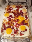 Breakfast meatza - layer of meat topped with bacon, sweet potato, eggs